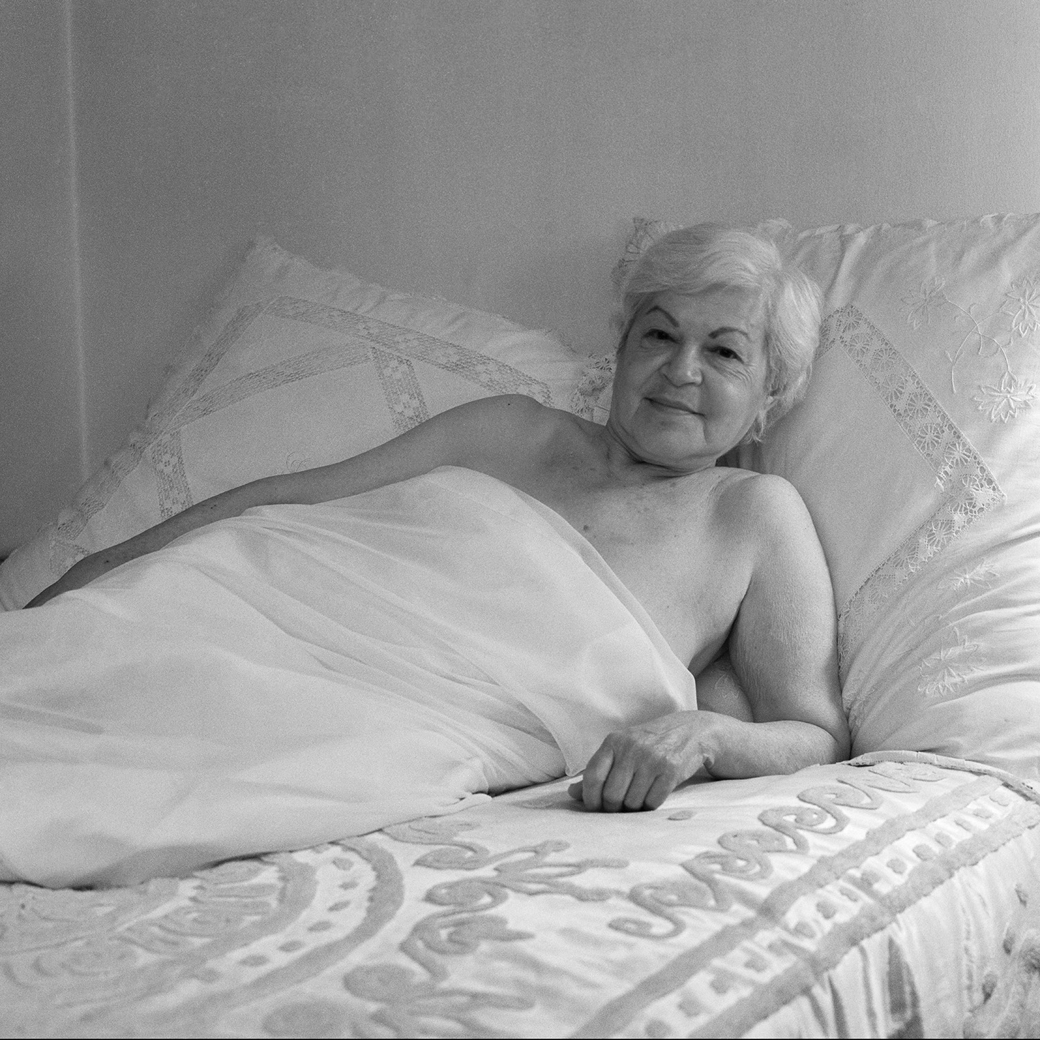 Sadie in white bed.jpg