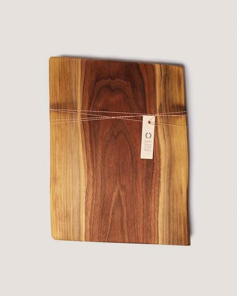 We love this live edge walnut board from Farmhouse Pottery. It has so much depth and character, and the richness of the wood definitely compliments those light-colored cheeses and dark-pigmented fruits.