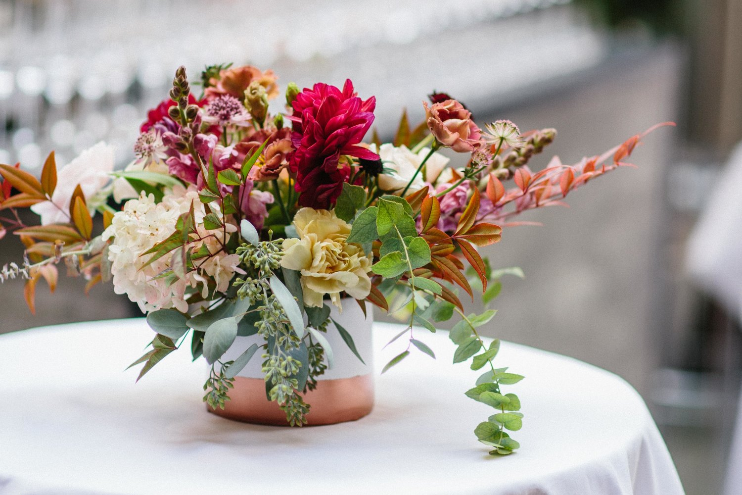 Jill Gaynor Floral Design - Jill holds a special place in our heart, we've collaborated with her a few times and it's always been a design heaven. this gorgeous bouquet she designed is a perfect reflection of her unique expression on blending color and shapes. she always pays close consideration to the vessel as the first step to designing her arrangements, and boy did this one hit the mark! we absolutely love the concrete and copper combination. it ties beautifully with the burnt orange leaves and flowers, le sigh, flowers are just so damn beautiful.