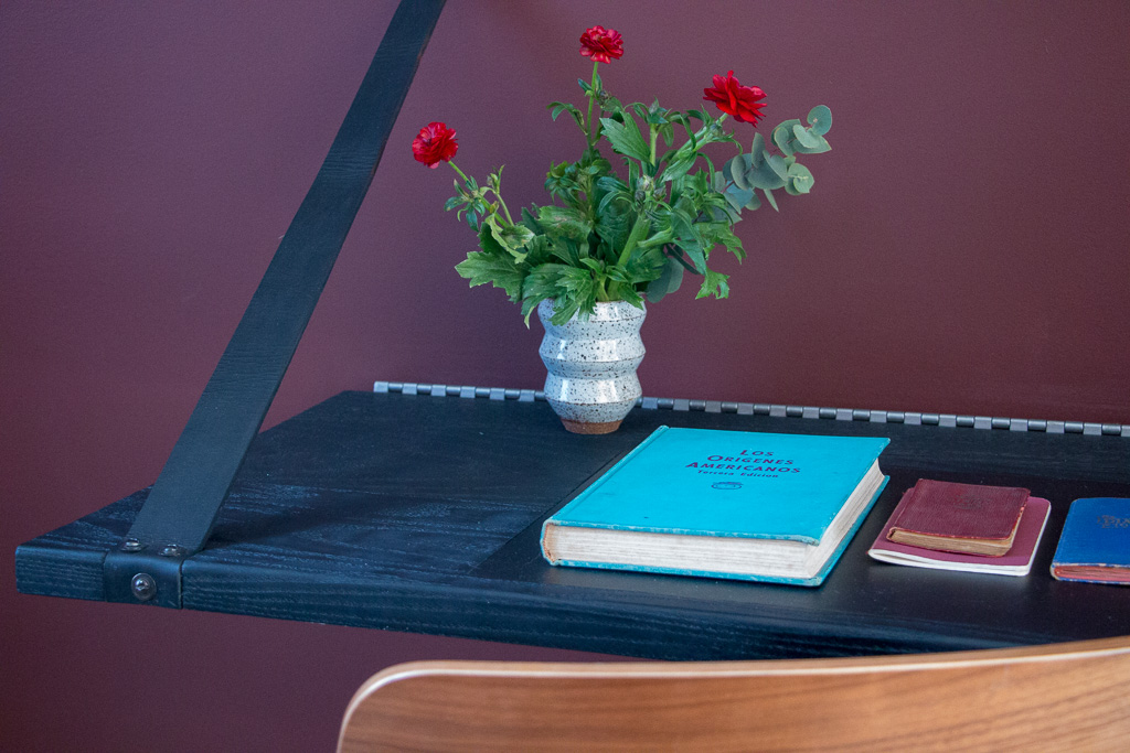 Folding desk by Nafco Studio  Materials: Ebonized Oak & Leather Strap  Location: Guest Bedroom,  Industrial Cast Iron Soho Loft