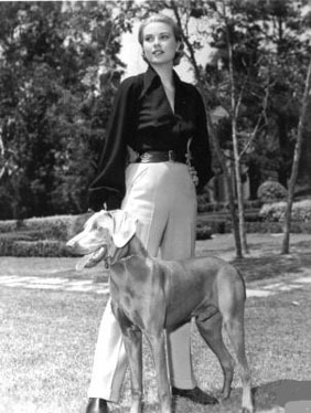 Grace Kelly (1956) and her Weimaraner, a wedding present from her brother jack, and given to her before she left America to marry Prince Rainier of Monaco in 1956.