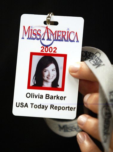"""Olivia's Miss America credential. The assignment """"let me step into the hose and heels and beaded gowns as the hypothetical 52nd contestant,"""" she wrote.  (Photo: Eileen Blass, USA TODAY)"""