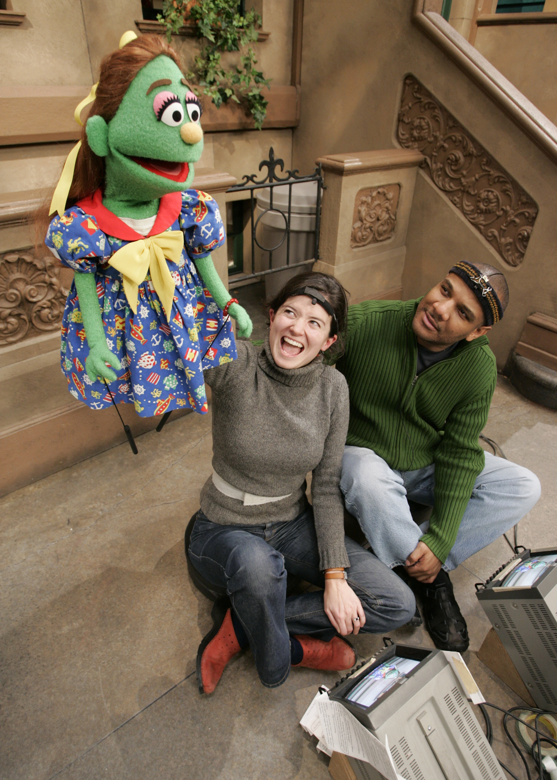 Olivia gets some instruction on how to work a puppet on the set of 'Sesame Street' in Queens, N.Y., for a behind-the-scenes story in 2004.  (Photo: Robert Deutsch, USA TODAY)