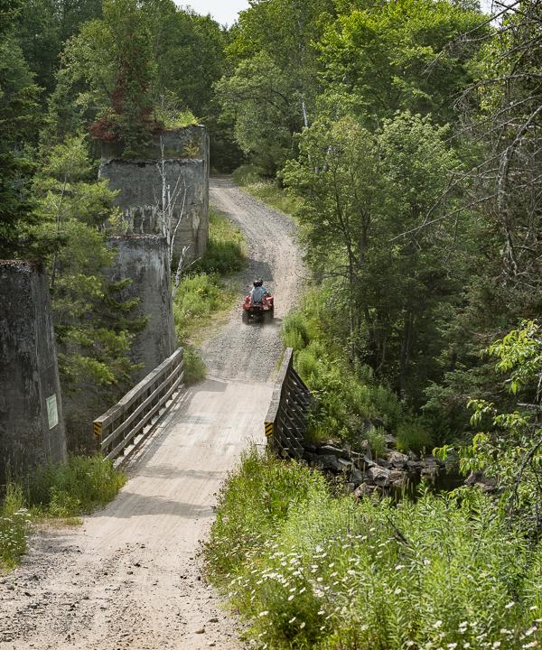 The old trestle structure alongside the bridge at Seguin Falls.