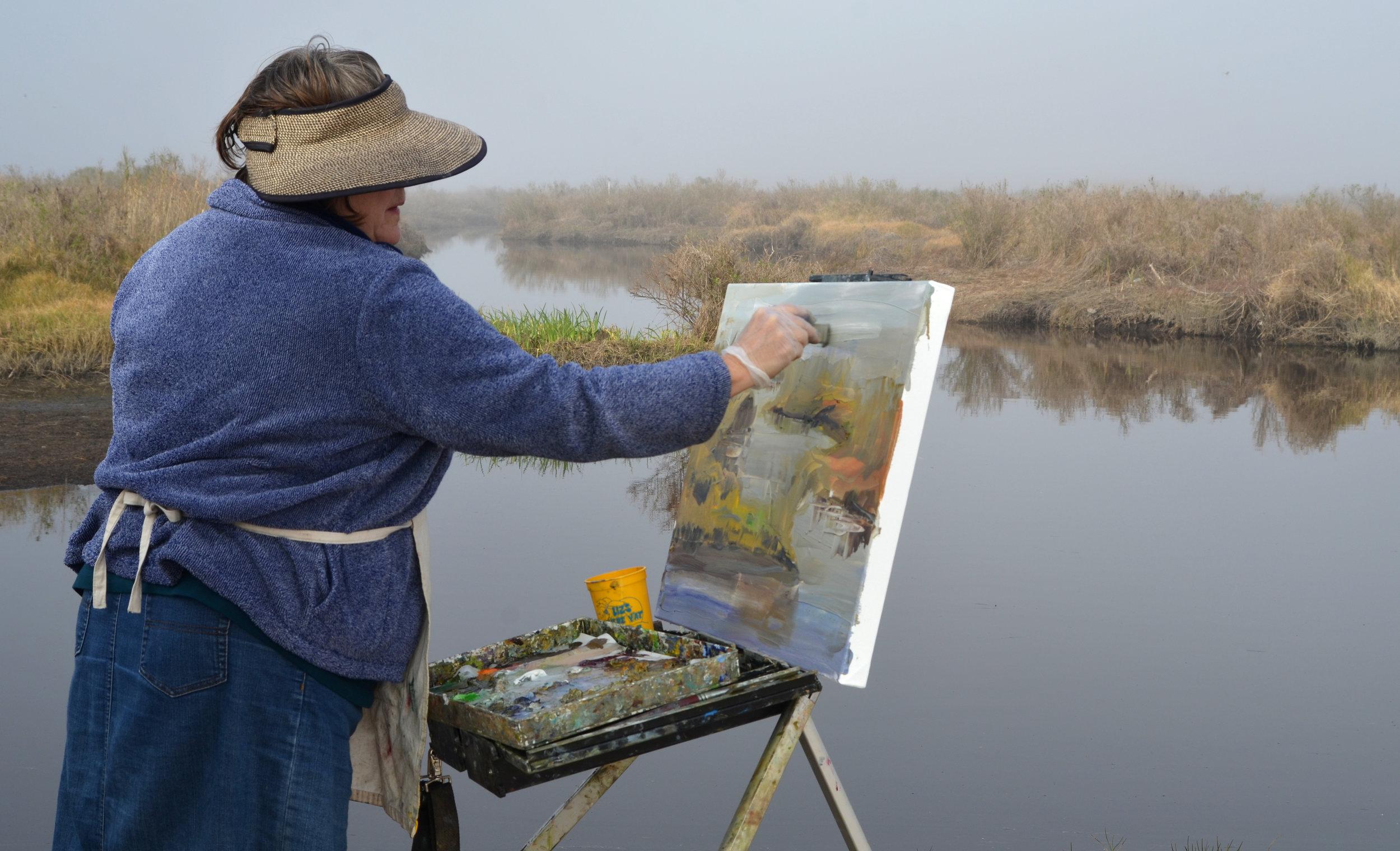 Carol Hallock working in the marsh, 2016