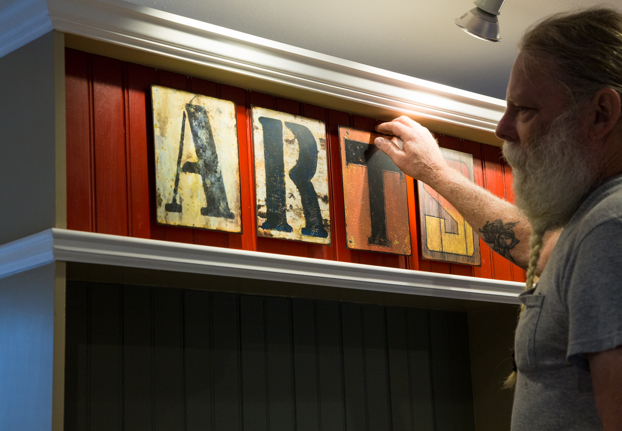 Mark Rhode finely constructs one of several new displays.