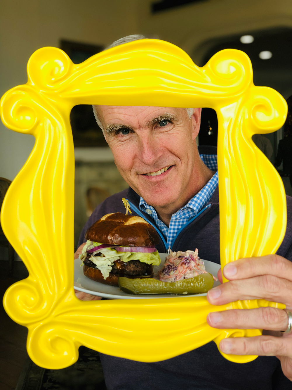 Todd Martin from the International Tennis Hall of Fame posing with our  Friends  picture frame and burger.