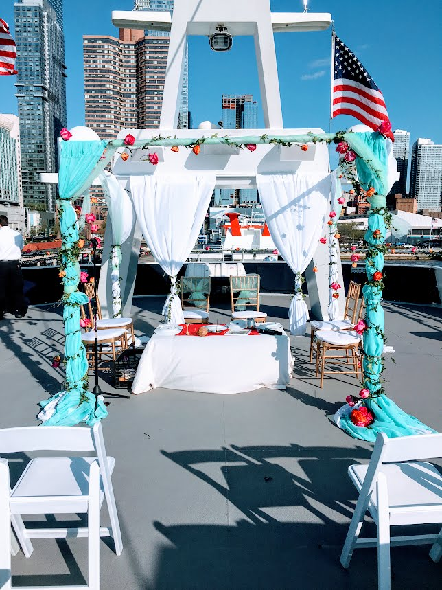 Drape & Fresh Floral Mandaps   The mandap above was designed for a wedding located on a private yatch.  Fresh floral garlands were designed and laced throughout the fabrics and mandap sides