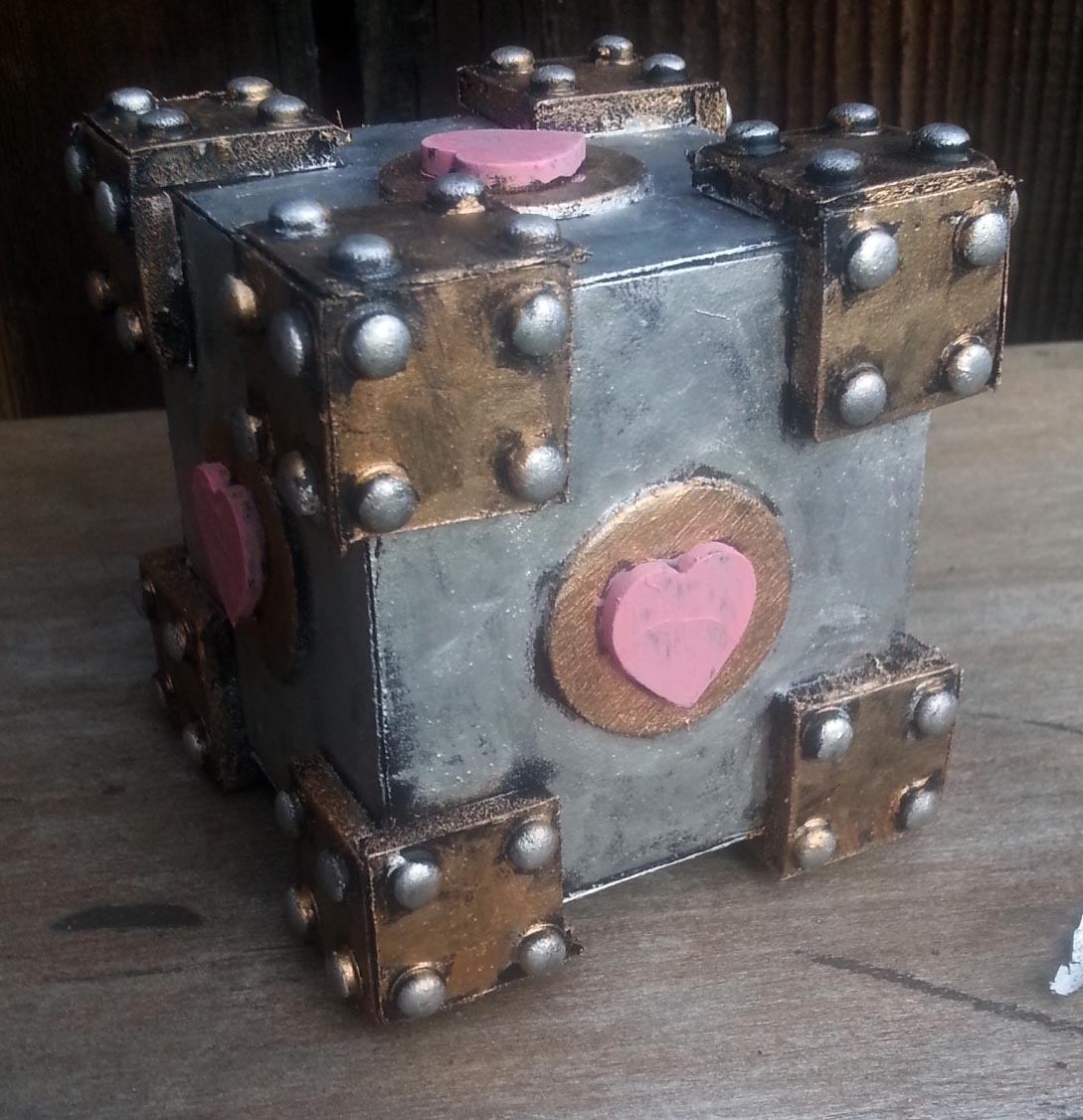 The original prototype for the cubes became Professor C. Johnson's Patented Companionship Cube which now lives with my friend Five.