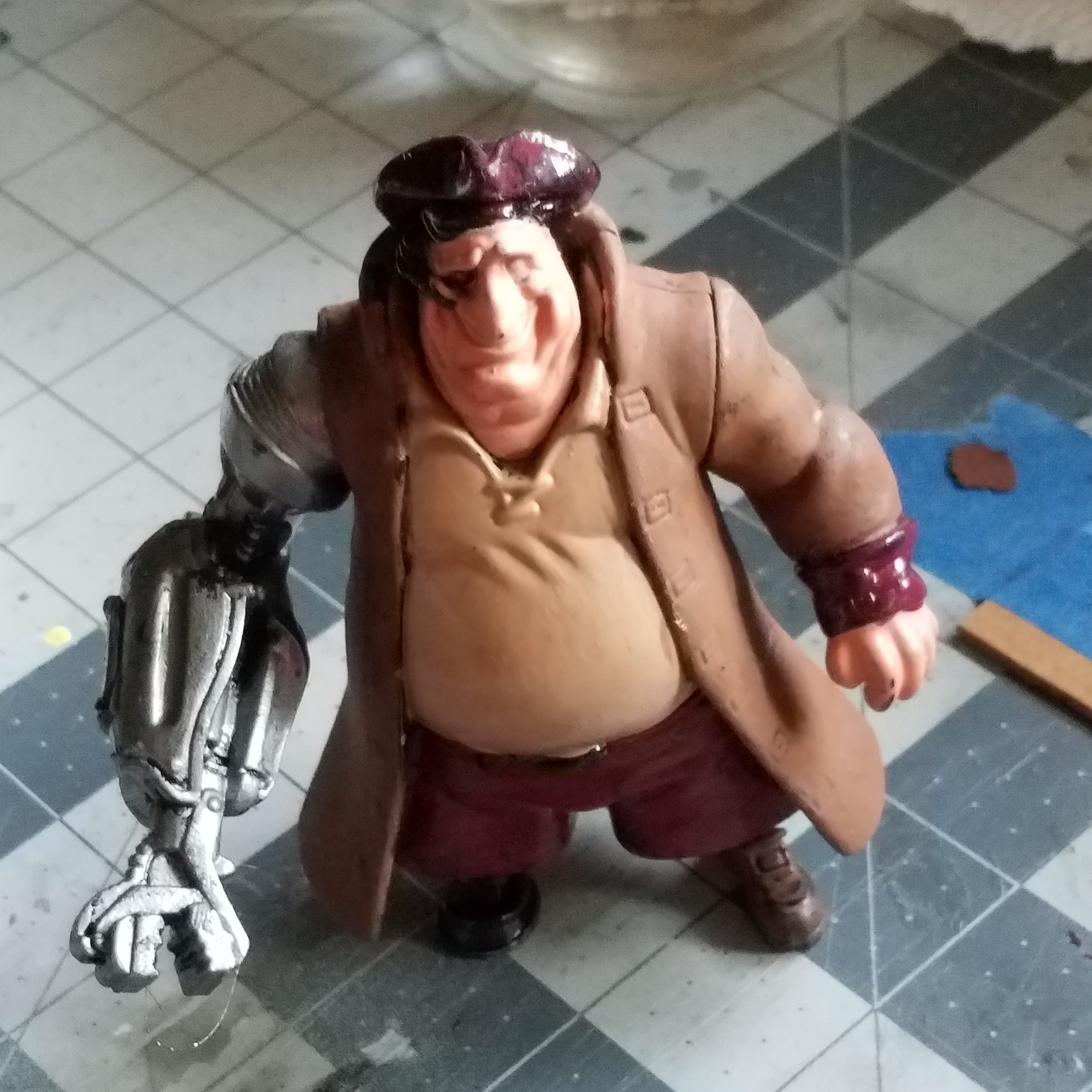 Space Pirate! I've had this figure from Treasure Planet for a while and decided to finally give it a repaint. Here we see a nearly completed base base coat.