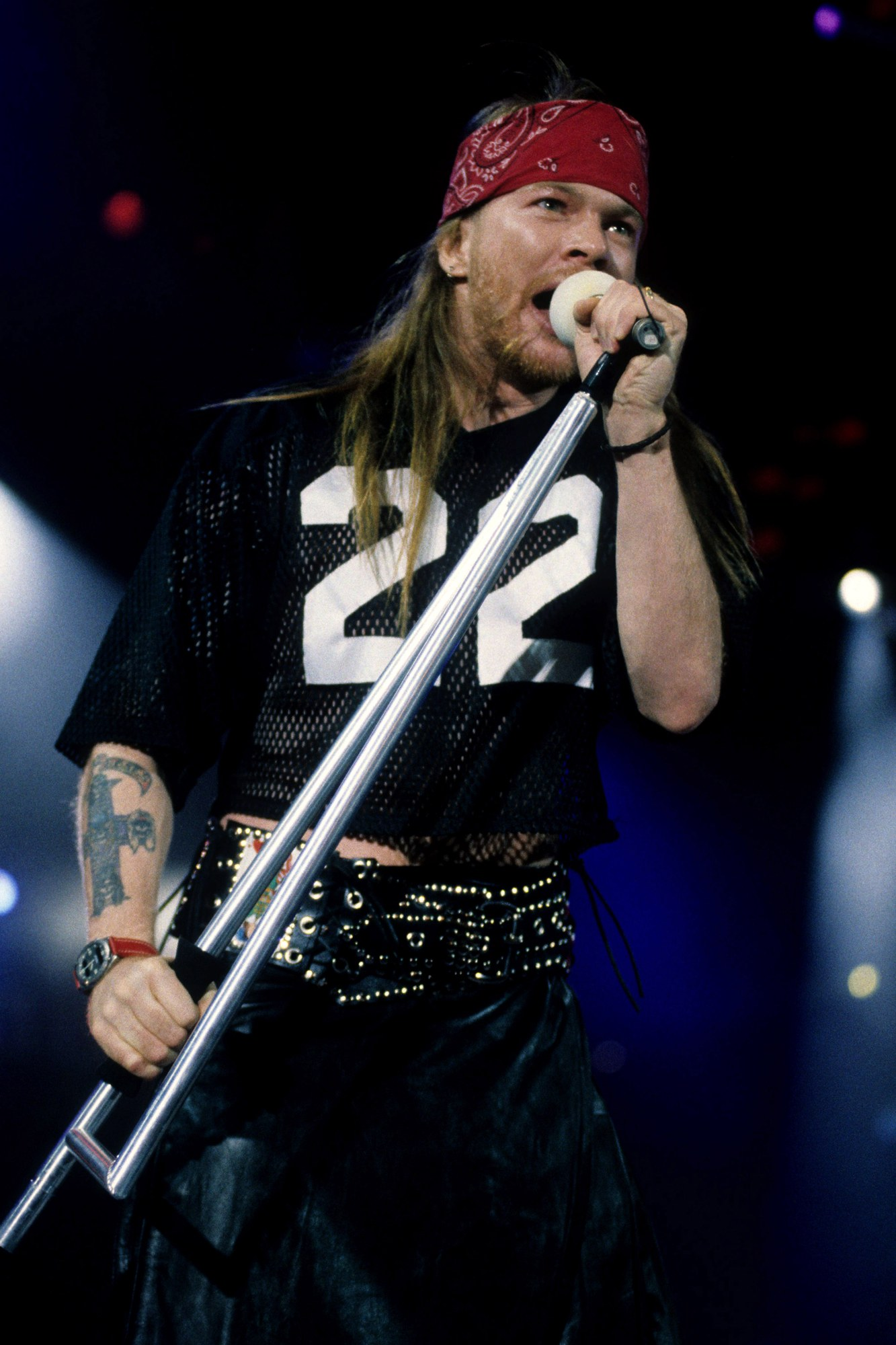 """On the screen, Axl Rose silently hopped across the stage in his bandana and cutoff shirt."""