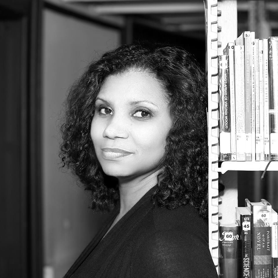 """Nelly Rosario - was born in the Dominican Republic and raised in Brooklyn, New York, where she now lives. She received a BA in engineering from MIT and an MFA in fiction writing from Columbia University. She was named a """"Writer on the Verge"""" by the Village Voice Literary Supplement in 2001. Her novel Song of the Water Saints won the 2002 PEN Open Book Award."""