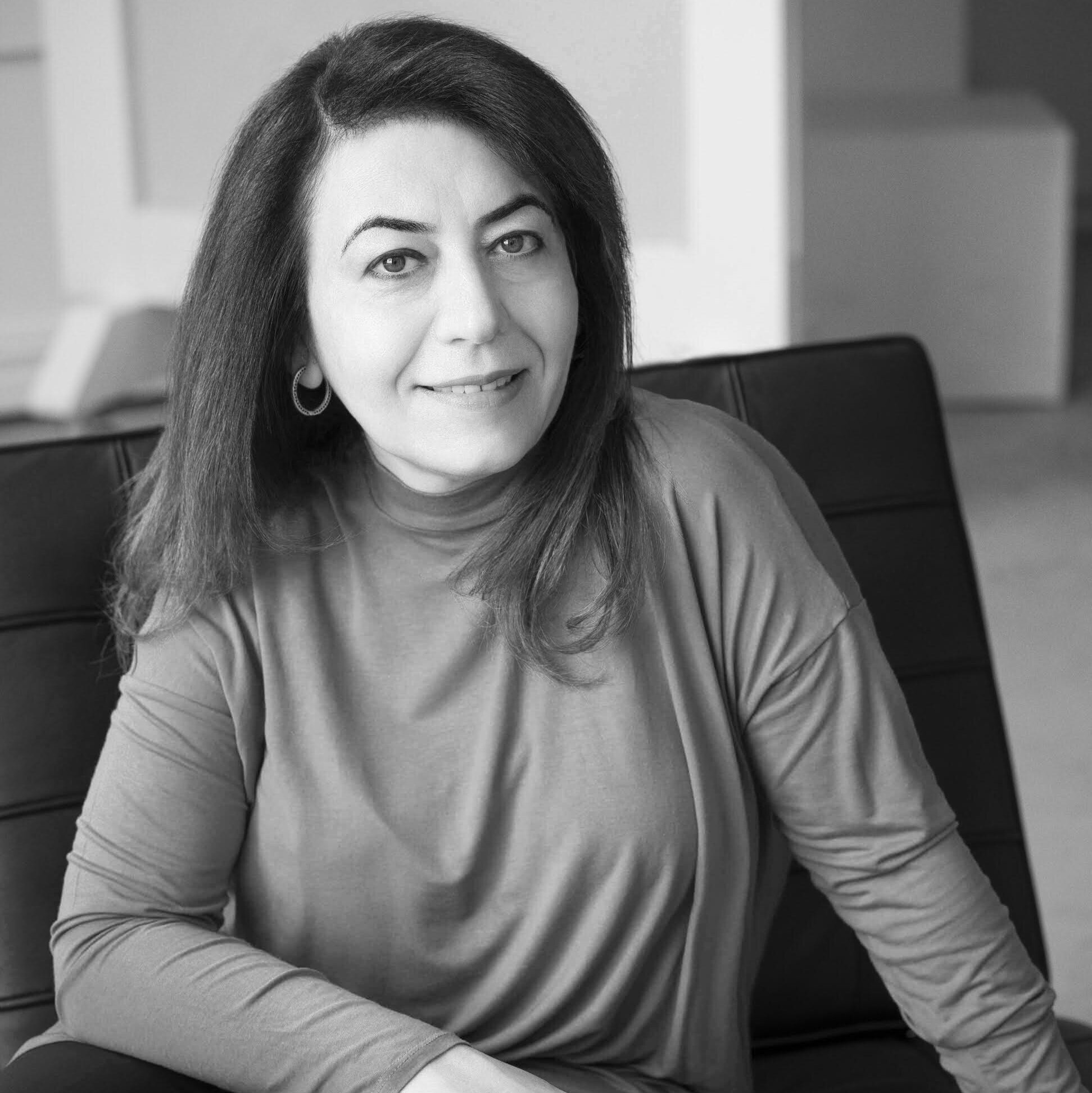 """Dunya Mikhail - was born in Iraq (Baghdad) in 1965 and came to the United States thirty years later. She's renowned in the Arab world for her subversive, innovative, and satirical poetry. After graduation from the University of Baghdad, she worked as a journalist and translator for the Baghdad Observer. Facing censorship and interrogation, she left Iraq, first to Jordan and then to America (Detroit). New Directions published her books in English: The War Works Hard (translated by Elizabeth Winslow), shortlisted for Griffin and named one of """"Twenty-Five Books to Remember from 2005"""" by the New York Public Library. Diary of A Wave Outside the Sea (co-translated with Elisabeth Winslow) won the Arab American Book Award. The Iraqi Nights (translated by Kareem James Abu-Zeid) and 15 Iraqi Poets (editor). The Beekeeper: Rescuing the Stolen Women of Iraq (co-translated with Max Weiss), finalist for PEN/John Kenneth Galbraith award in non-fiction and long-listed for the National Book Award, selected by The New York Times as one of 8 recommended books of the week, and by The Christian Science Monitor as one of top 10 of the month, and by Publisher Weekly as one of top 10 of spring season. In Her Feminine Sign released in July, 2019. In an NPR interview, Mikhail's honors include the Guggenheim Fellowship, the Knights Foundation grant, the Kresge Fellowship, and the United Nations Human Rights Award for Freedom of Writing. She is the co-founder of Michigan-community-based Mesopotamian Forum for Art and Culture. She currently works as a special lecturer of Arabic at Oakland University in Michigan."""