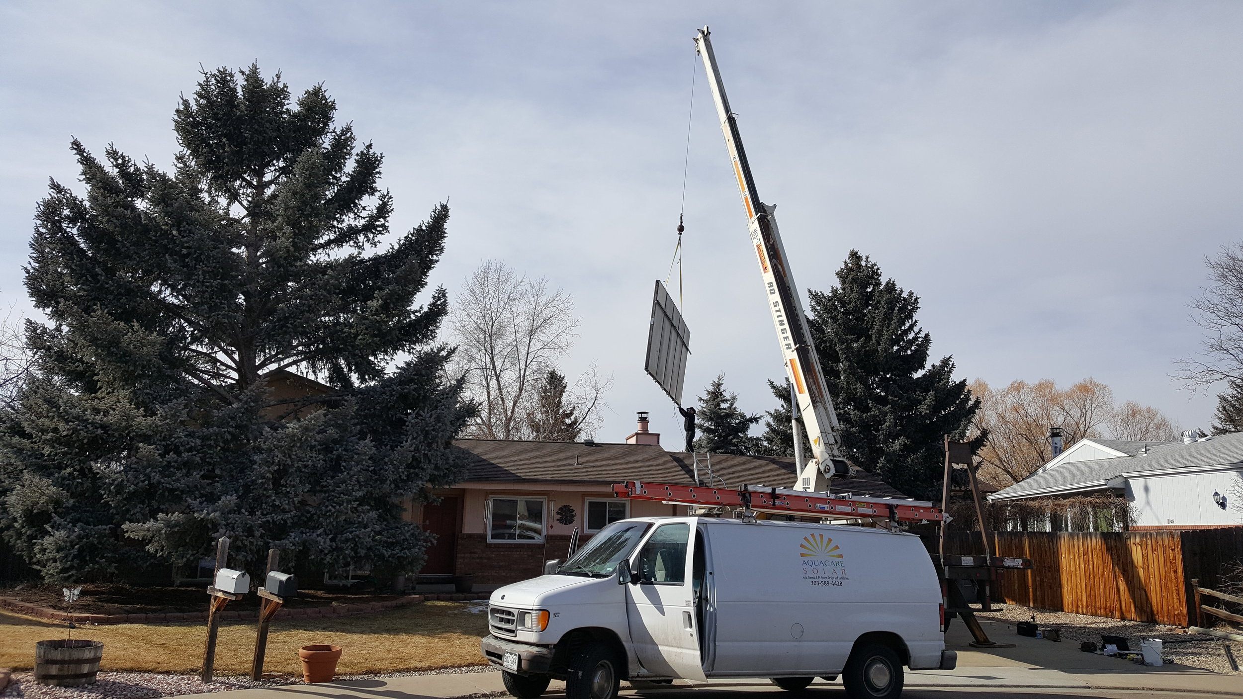 Crane reinstall of new solar thermal panels