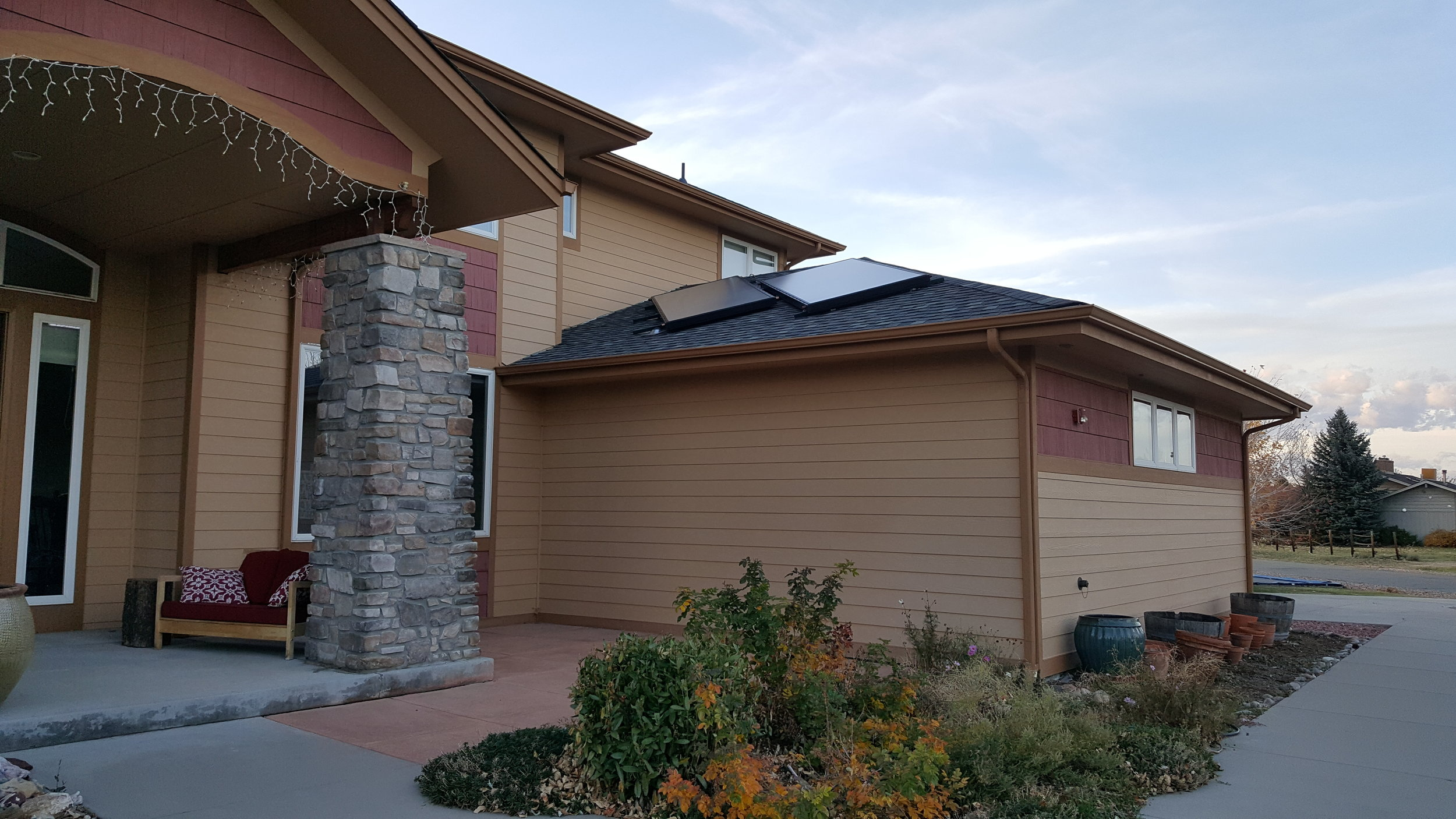 Flush mounted, offset & piped in series solar thermal array in Boulder, Colorado