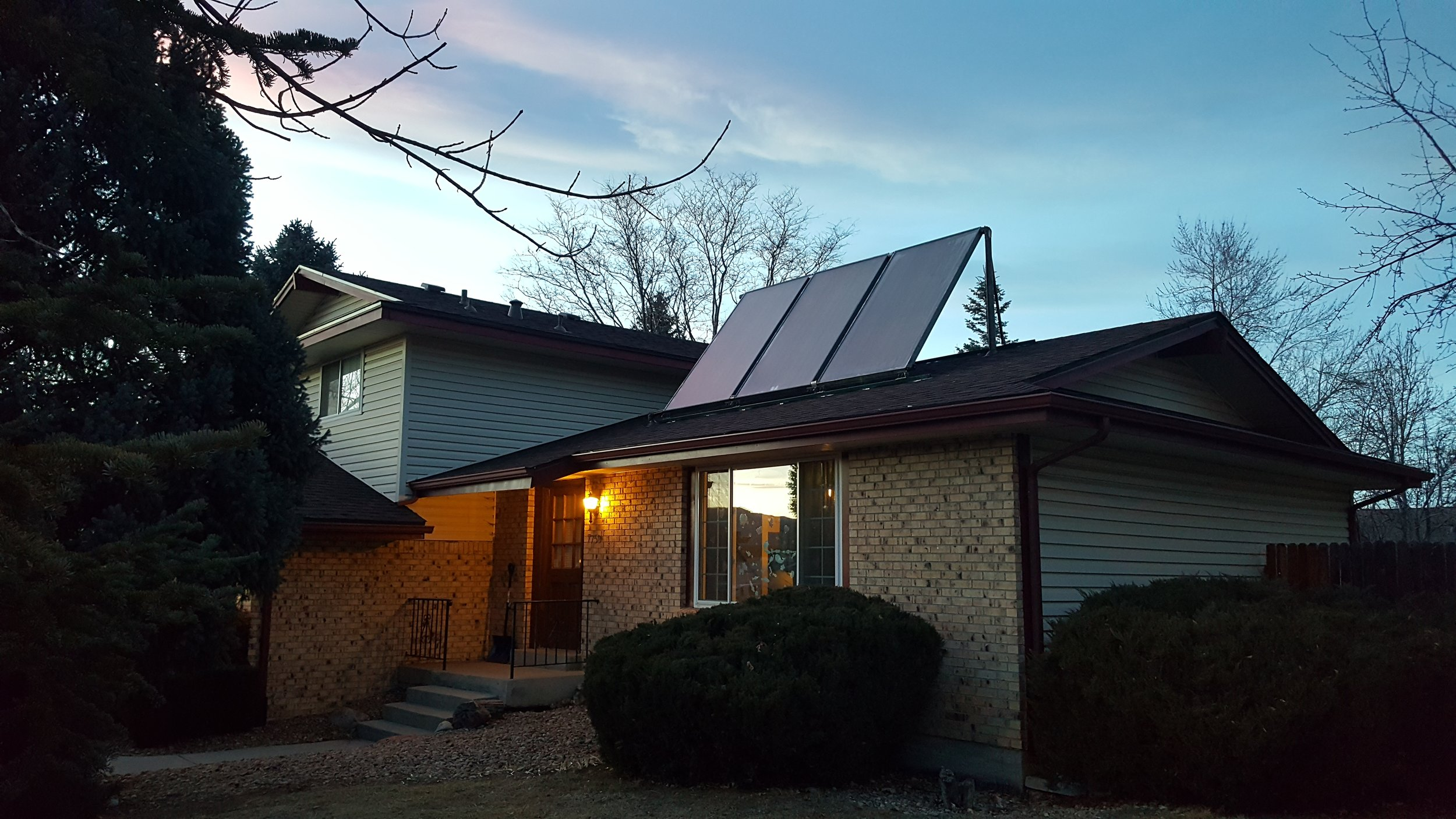 Tilt up, three solar thermal panel system in Boulder, Colorado