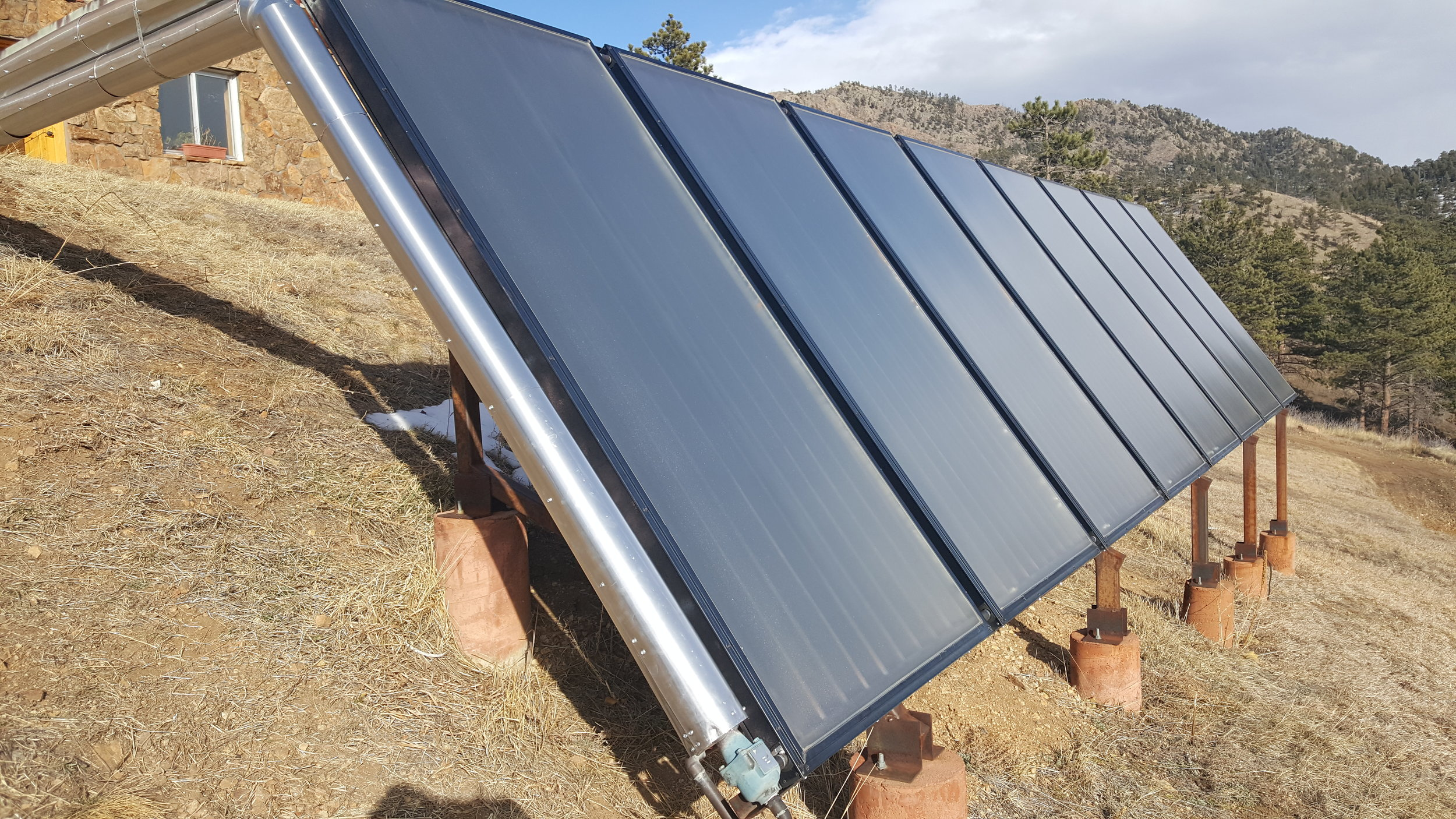 Eight ground mounted solar thermal panels in Jamestown, Colorado