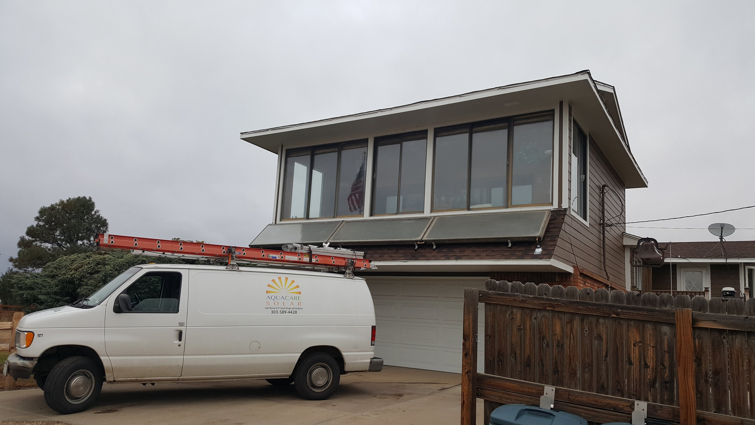 Three horizontal solar thermal panels in Brighton, Colorado