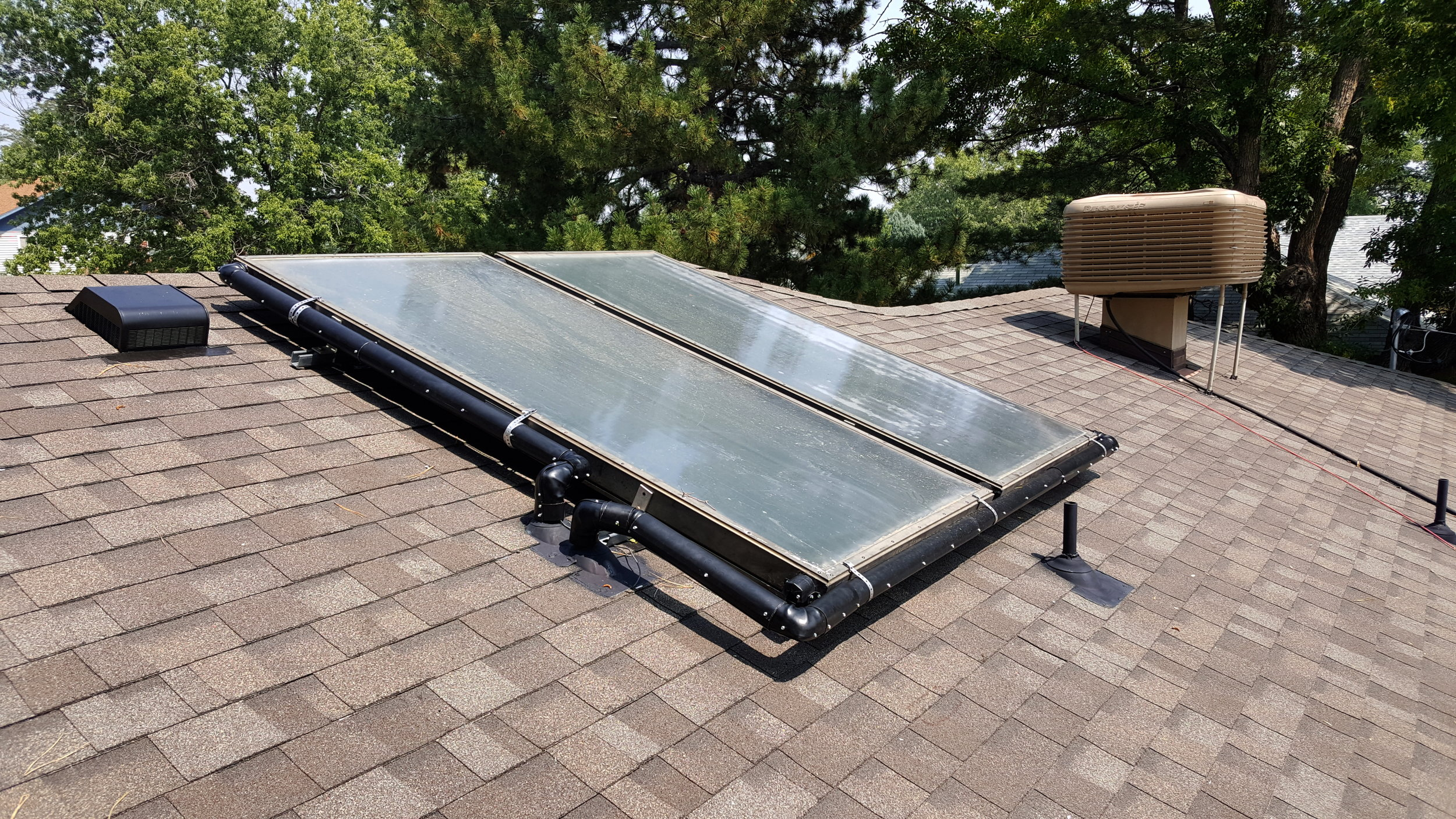 Two flush mounted solar thermal panels after there was roof repair due to a hail storm in Lafayette, Colorado