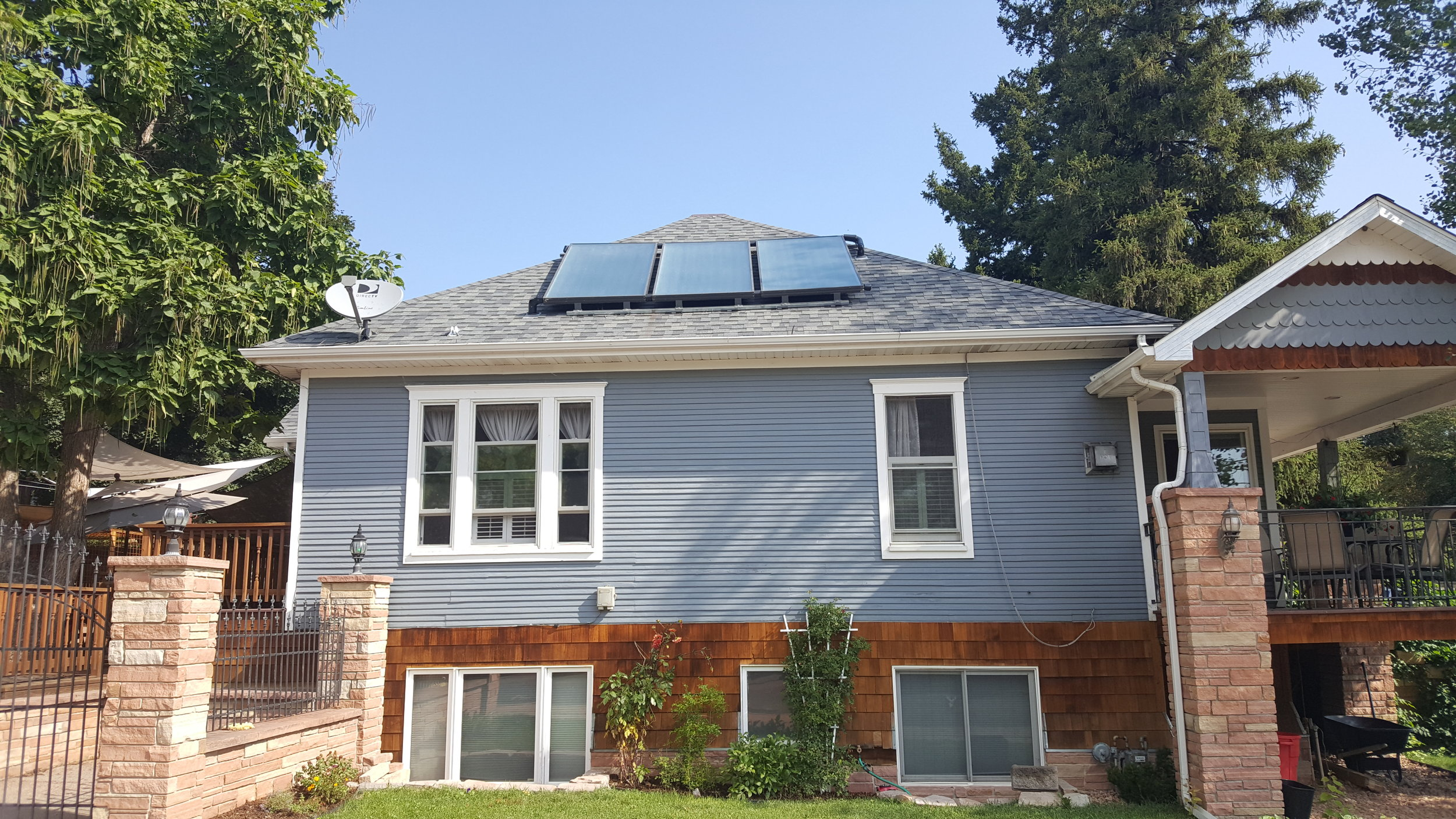 Three flush mounted solar hot water panels in Louisville, Colorado