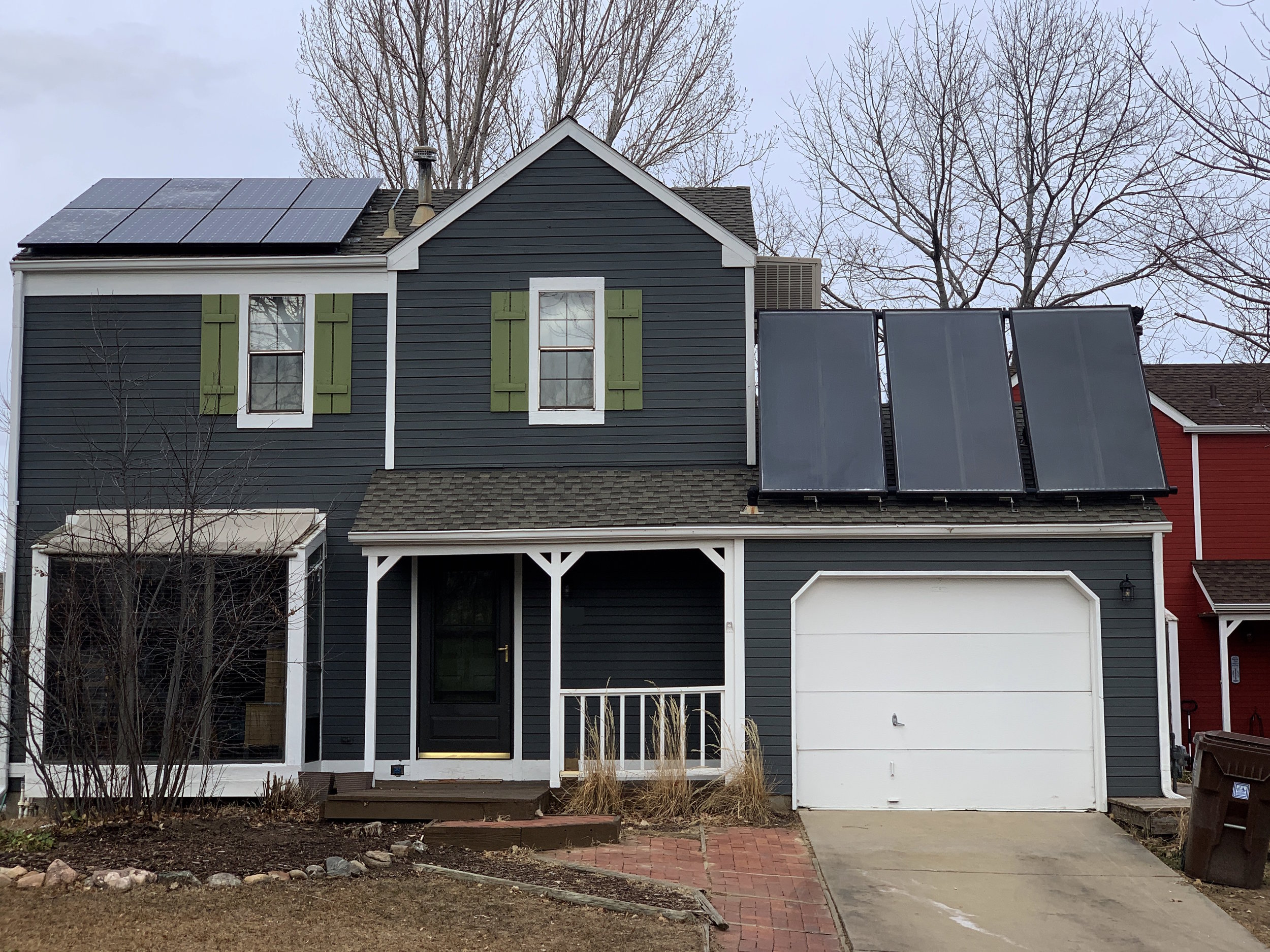 Three tilt up solar hot water panels coupled with solar PV located in Louisville, Colorado