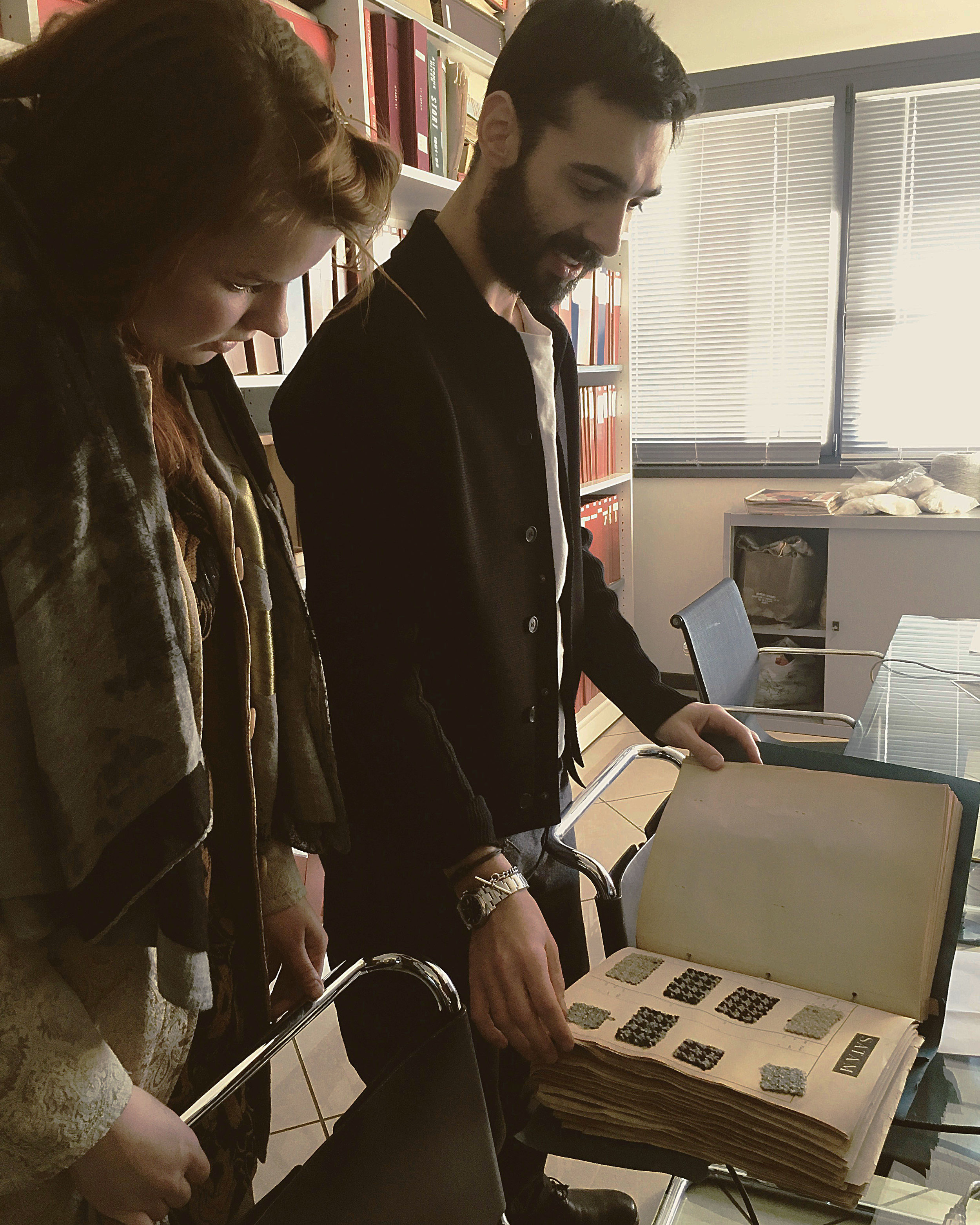 Liselore and Guido from Lanificio Bisentino looking at archive materials