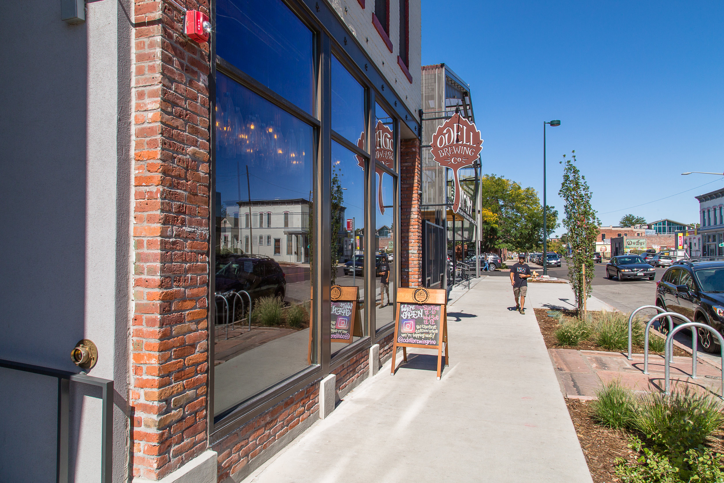 PROJECT DESCRIPTION - The 30th & Larimer project included both adaptive-reuse and ground-up construction of three stand-alone facilities on one project site. The end products include retail, restaurant, office, fitness, brewery and other ancillary uses.