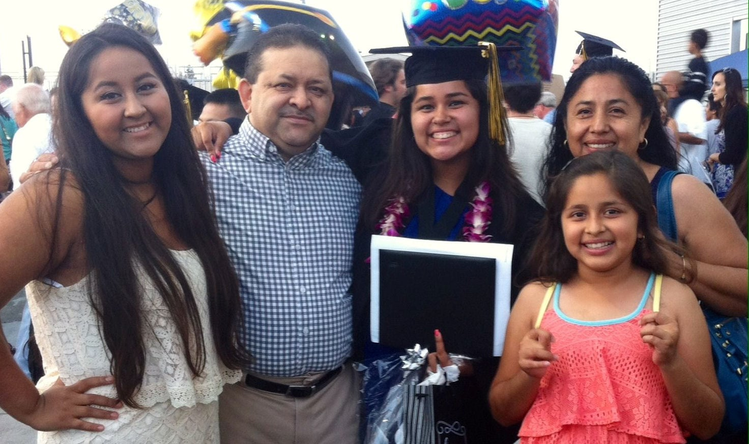 Verenice with her family at her graduation last summer.  Her little sister Amanda (lower right) is going to The Oaks for the first time.