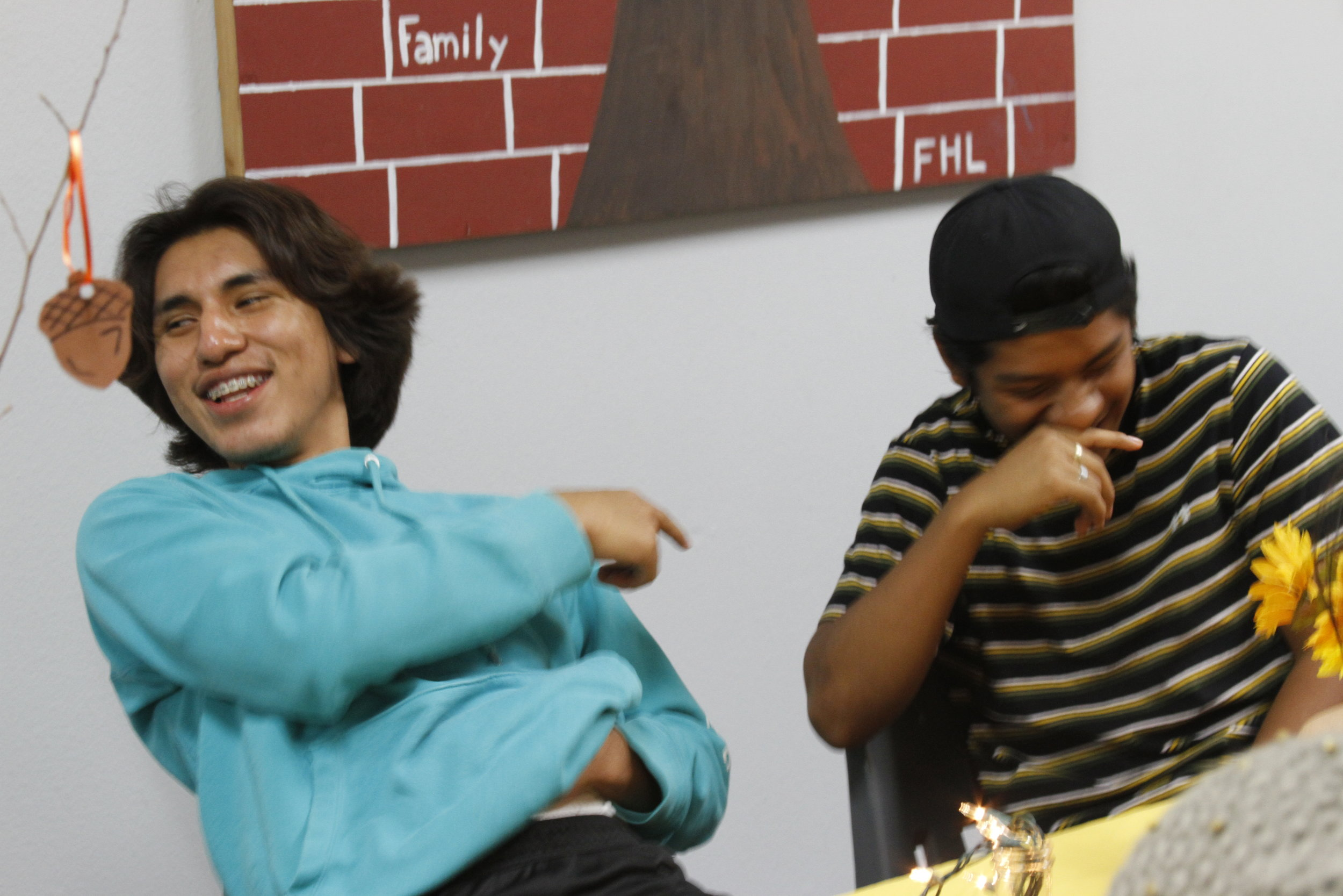 "Pedro & Kevin share a laugh as the Merge family plays the ""3 Facts"" game."