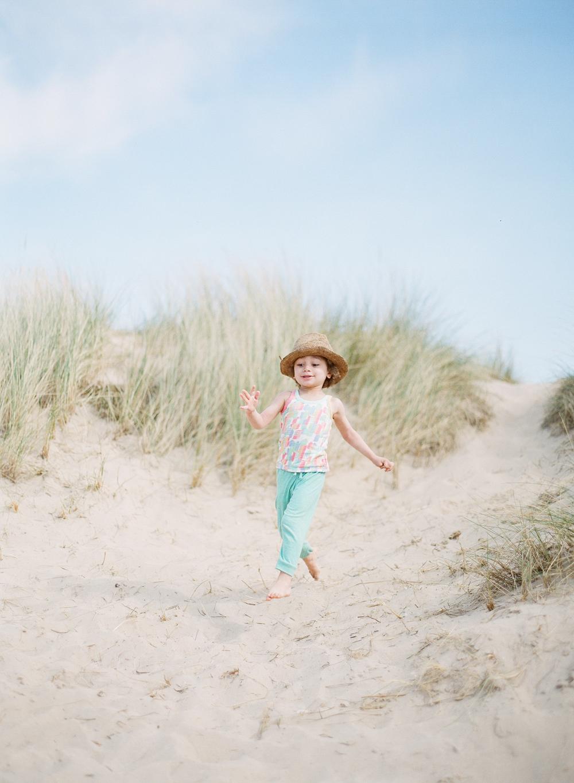 running down sand dunes