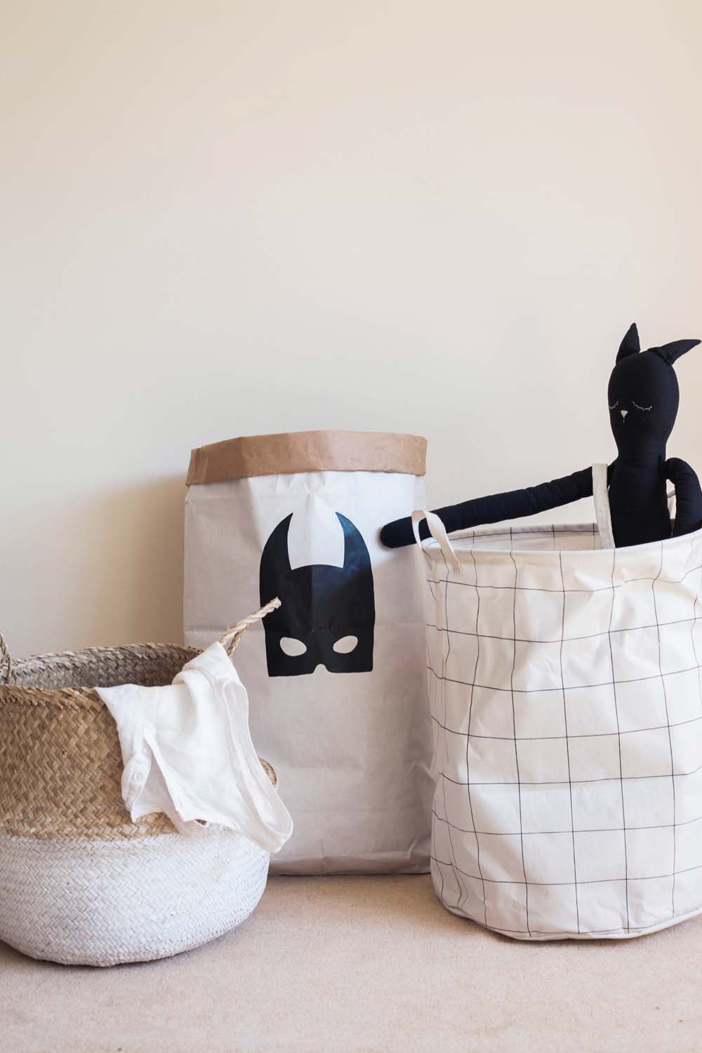 White Dipped Belly Basket by Oliella , Bat Mask storage bag by Hello Henry and  Squares Storage Bag by Southward Stores .