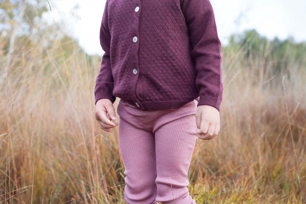 Eve wears leggings and cardigan by Minimalisma and boots by Clarks Shoes.