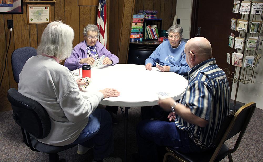Patrons playing cards at Davenport Senior Center
