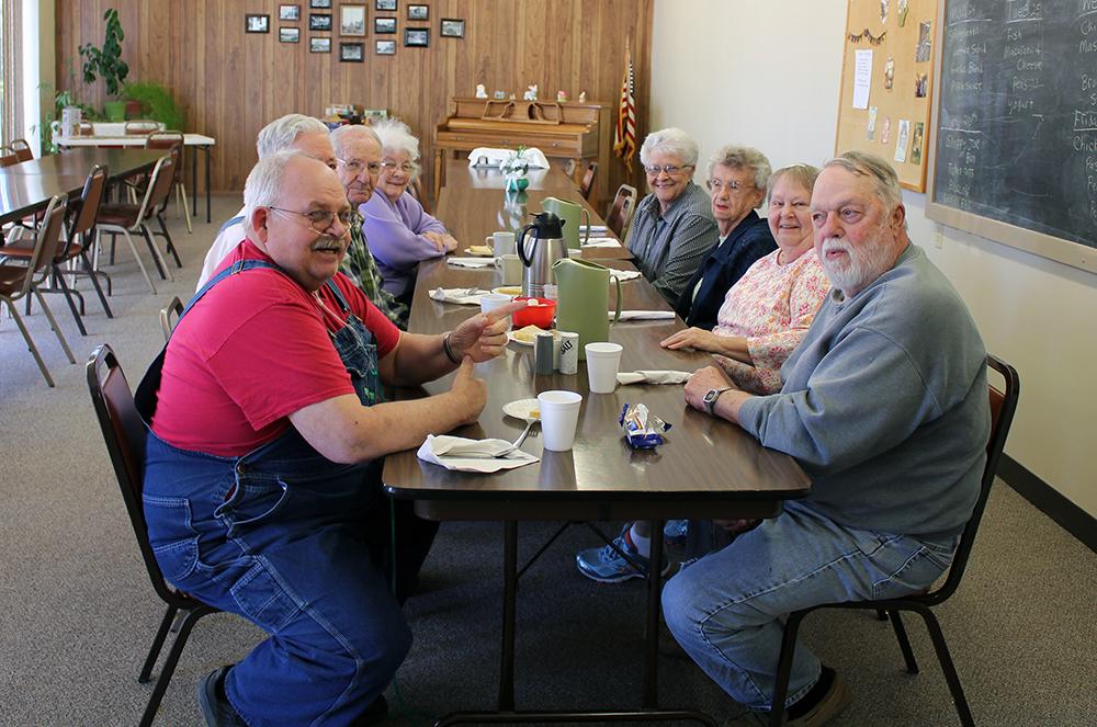 Deshler Site Manager Patricia Mueller and patrons at Deshler Senior Center