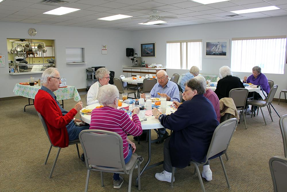 Enjoying a meal at Syracuse Senior Center