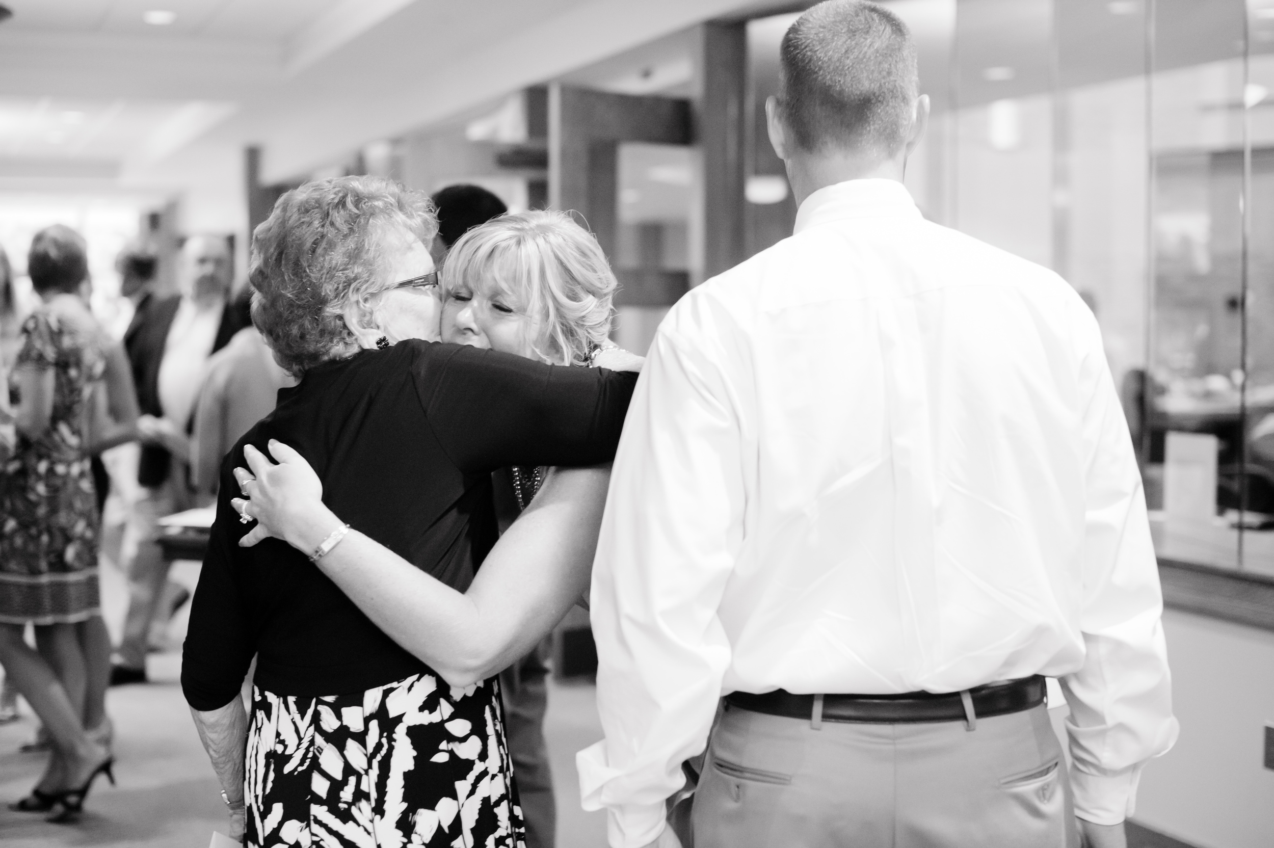 My mom hugging her mom at my wedding. Zero tears were shed that day. That is false. {Photo by TAK Photography.}
