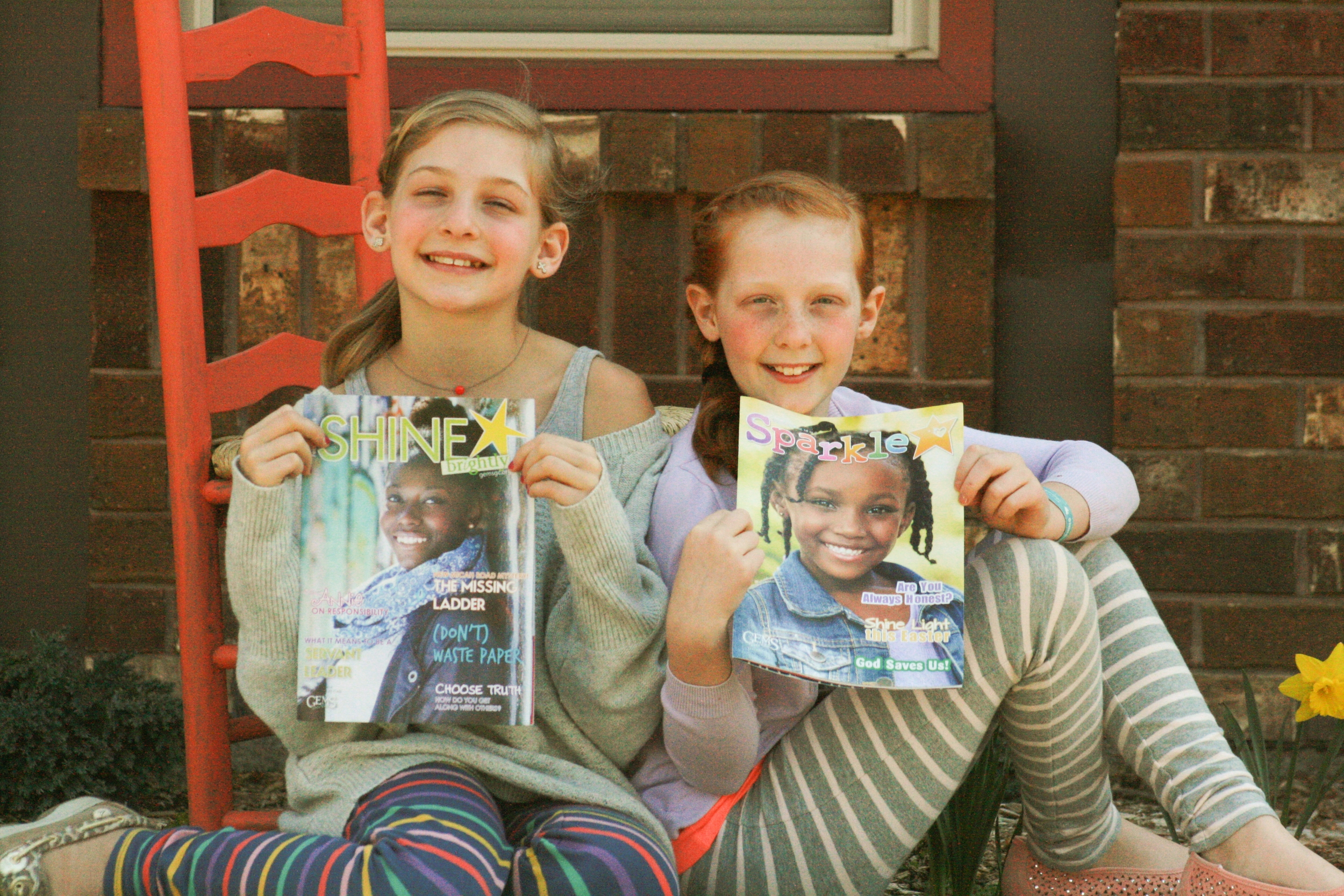 My lovely nieces Faith and Felicity, GEMS Girls Club attendees as well as  Sparkle  and  SHINE   brightly  readers.  Sparkle  is written for girls ages 6-8, and  SHINE   brightly  is written for girls ages 9-14. These magazines are used as curriculum for GEMS clubs, but are also available by subscription. Read to learn more and also find out how you can win a free yearlong subscription to one of these two magazines! {Photos by Amber VanderVennen.}