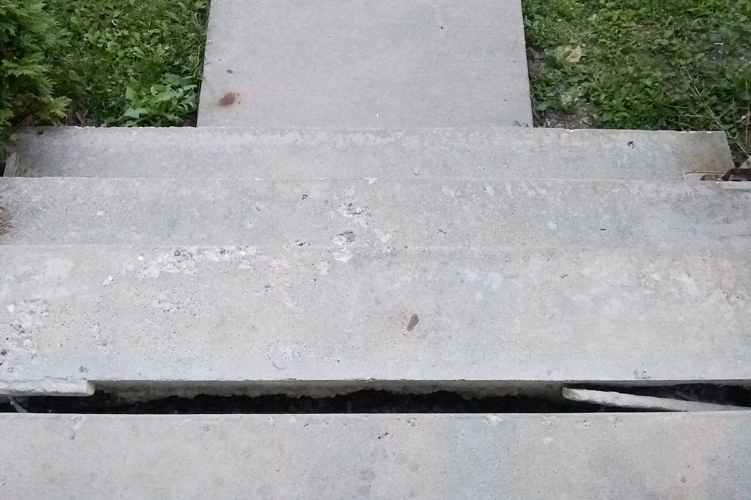 {A bird's eye view of the stairs leading up to our front porch. Before a piece of wood was jimmied in to fill the crack. #PrivilegedToBeHere}