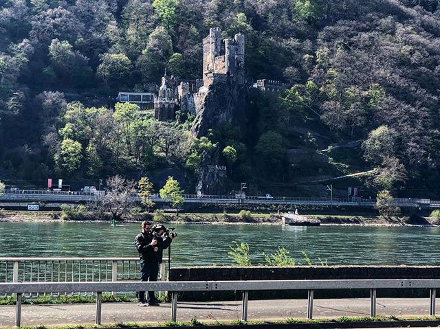 Rhein River Valley Castles are amazing to shoot.  Here @mr_stegs and @rkolegas are shooting one majestic castle with another lurking behind them! . . . . #history #castle #shotoniphone #producer #work #worktravel #germany🇩🇪 #bestcrew