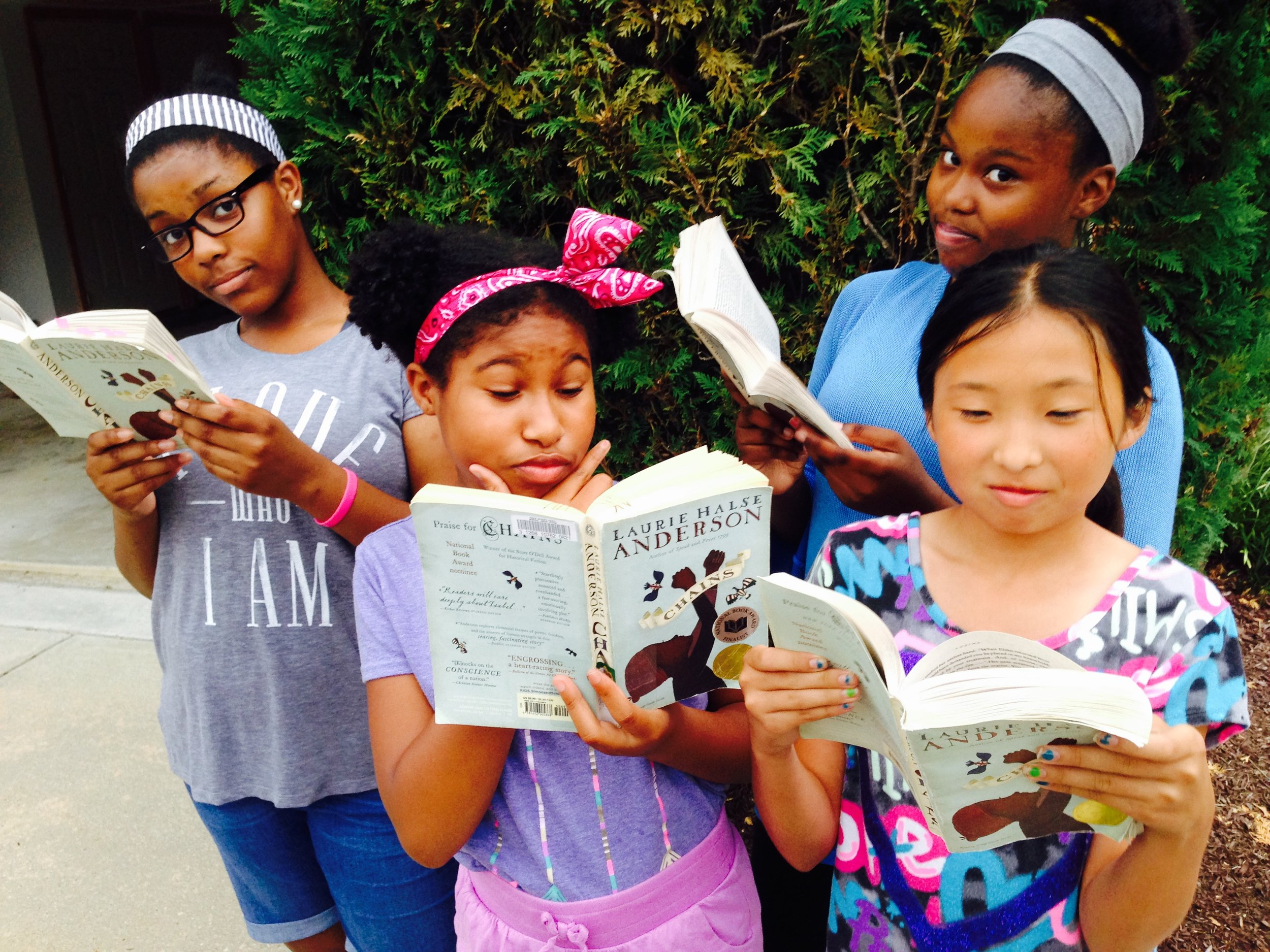 This book club in Maryland discuss historical fiction and seventh grade boys.