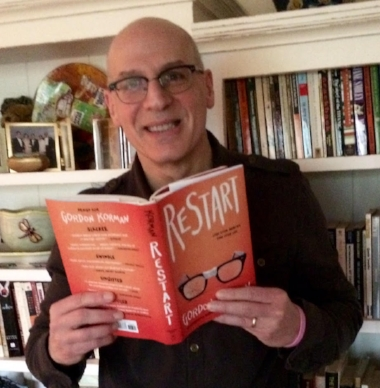 Writer  Gordon Korman  shows off his latest book.