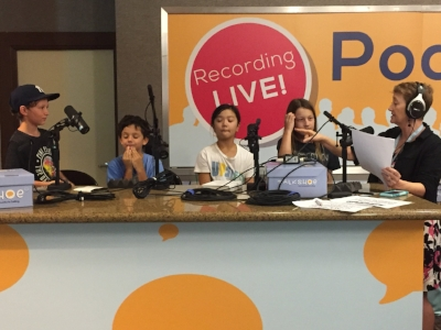 Tristan, Mateo, Luna, and Logan with host Kitty Felde, taping this episode live at the Podcast Movement convention in Anaheim.