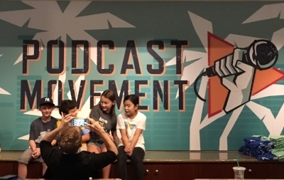 Posing for the official portrait at Podcast Movement in Anaheim