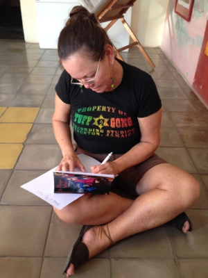 Writer Isora Morales Suarez autographs her novel