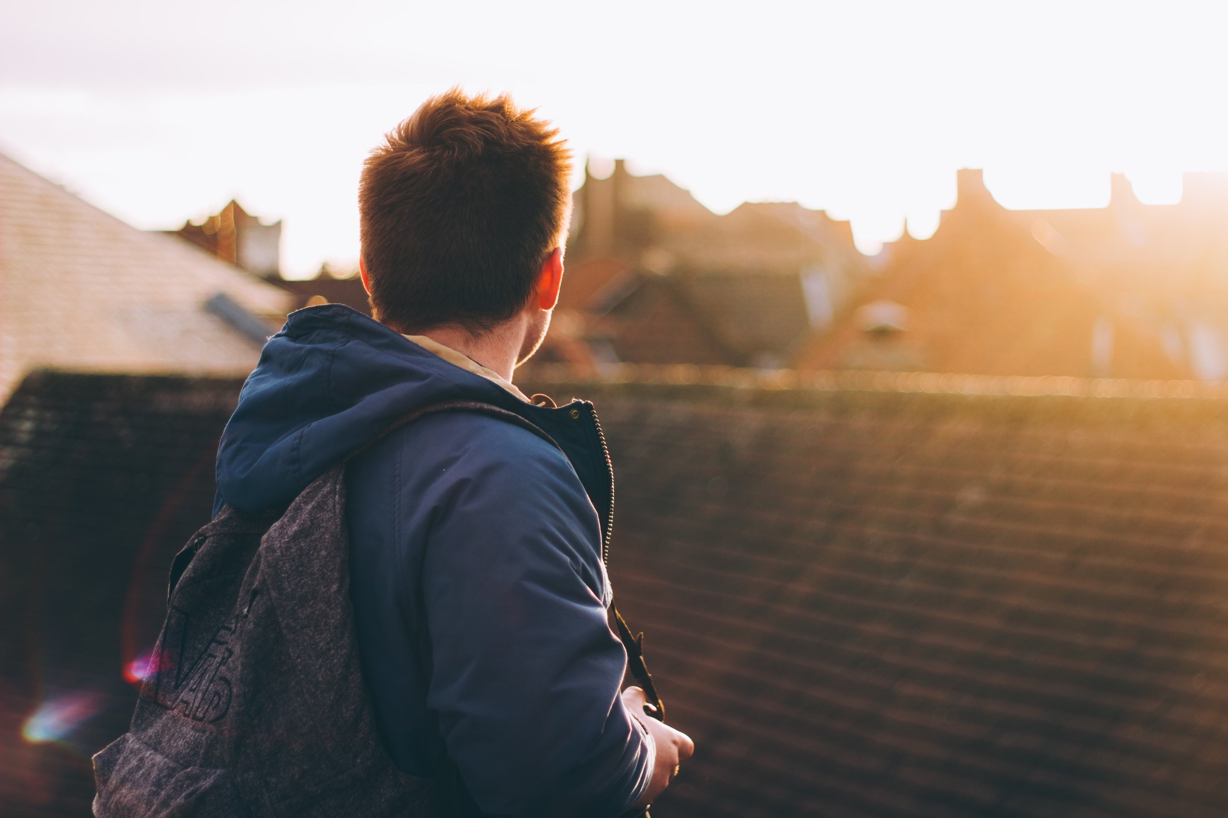 Student with backpack facing away (photo credit Viktor Hanacek).