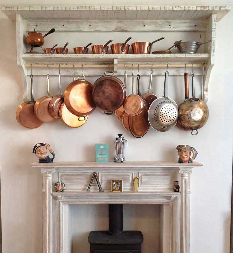 Shelves in a bespoke fitted kitchen.