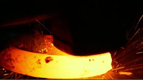 890330992-forging-blacksmith-hammer-tool-glowing.jpg