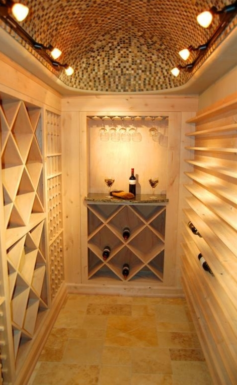 In the home's wine cellar we installed a custom travertine floor. We also spent two days lying on a scaffold to individually set hundreds of slate pieces following the curved arch to create this one of a kind ceiling.