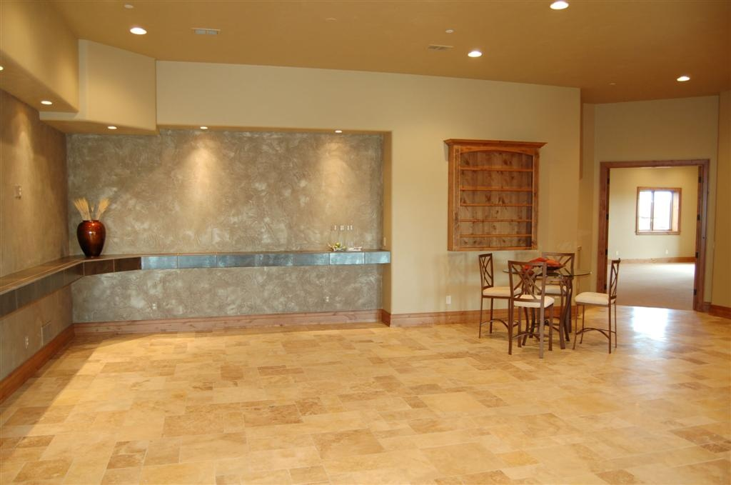 Every rectangular tile on this floor was cut to fit on site. Also, here is a metallic porcelain counter top.
