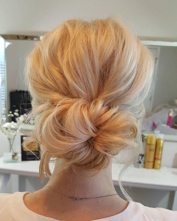 75b68d9acf306c92b7974a98495a575c--hair-buns-prom-hair-bun-low.jpg